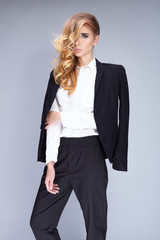 Beautiful young woman wearing black suit