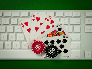 Cards and chips for poker on keyboard.