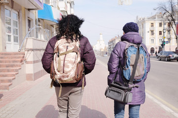 Rear view of female travellers