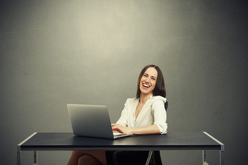 attractive laughing woman working