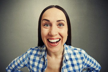 laughing woman over grey background