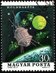 Flight of moon spaceship on post stamp
