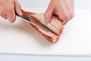 cook separates fish fillet