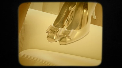 Bride Taking Wedding Shoes Off The Sofa