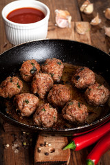 Fried meatballs on the pan