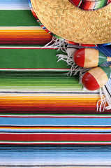 Mexican serape blanket with sombrero © david_franklin
