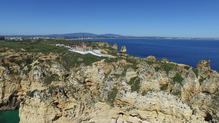 Aerial from Ponte Piedade and the lighthouse in Lagos Portugal