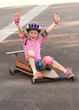 Girl playing with a soapbox cart - 81202370