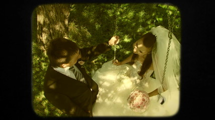 Happy Groom Swinging His Beautiful Bride