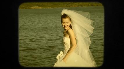 Happy Bride Walking Near Lake