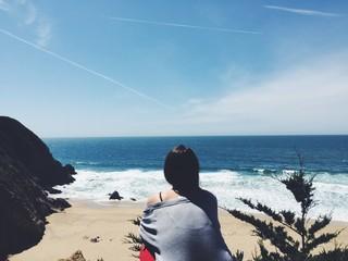 female looking at ocean