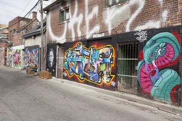 : Grafitti lined buildings in Kensington  Market