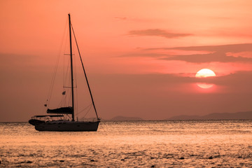 The sailboats were anchored for the evening to watch the sunset