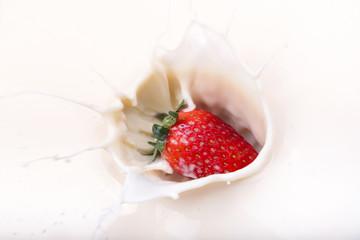 Strawberry splash on milk