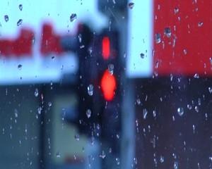 Rain on a window pane.Traffic light