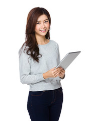 Smiling asian young woman watching the tablet pc