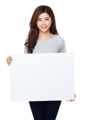 Pretty asian woman holding a blank whiteboard