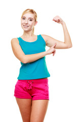 Young woman teen girl showing her muscles