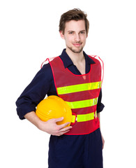 Smiling construction worker in yellow helmet and lime waistcoat