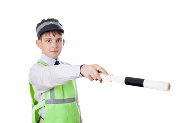 Ten-year-old boy plays policeman, isolated on white background