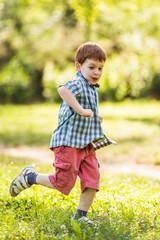 Happy boy running in park