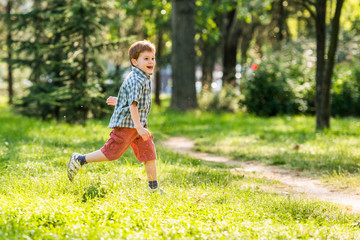 Cheerful boy running in park