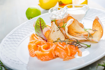 Sliced salted salmon served with bread