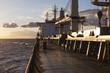 Cargo ship underway at sunset - 81211316