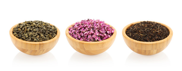 Assortment of tea in wooden bowl. Green tea, darjeeling, red bud