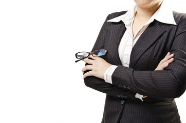businesswoman stand with arms crossed and holding glasses
