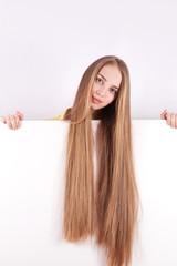 Girl with long hair holding a white stand