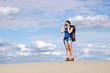 beautiful girl with camera hiking in desert