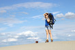 girl hiker with a backpack in the desert
