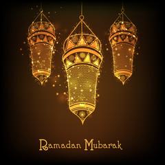 Golden Arabic lantern for Ramadan Kareem celebration.