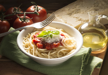 dish with spaghetti and its ingredients on the wooden table
