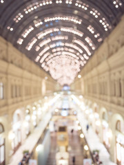 Defocused interior of a large luxury shopping center.
