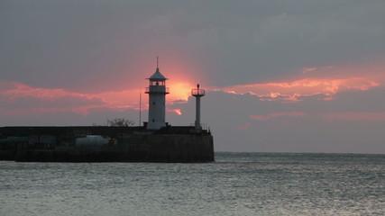 Sunrise over the Black Sea against a beacon in Yalta