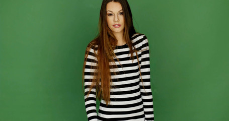 Young Woman in Trendy Black and White Stripe Dress