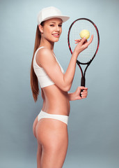 Woman in Underwear with Tennis Racquet and Ball