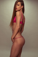 Sensual Woman Posing in Solid Fuchsia Lingerie