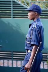 Security Guard black, guarding a door