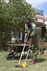 African gardener tending a garden