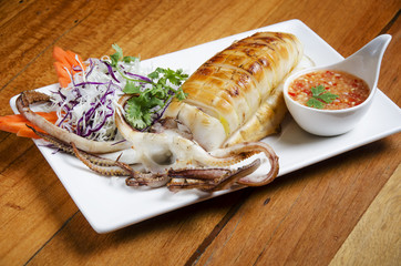 Delicious BBQ cuttle fish on white dish