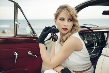 Elegant woman in vintage car