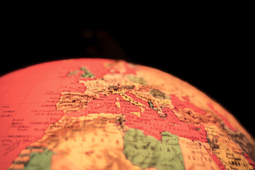 europe on terrestrial globe with blurred focus