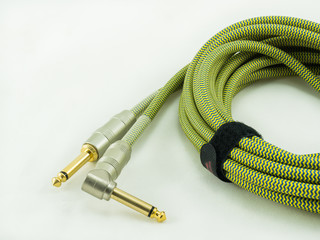 Guitar cable on white background