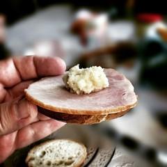 Horseradish on the Polish ham. Morning breakfast.