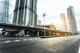 skyline,road and office buildings at sunset - Fine Art prints