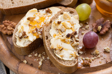 bread with butter, honey and nuts, horizontal, top view