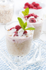 dessert with oatmeal, whipped cream and raspberries, close-up